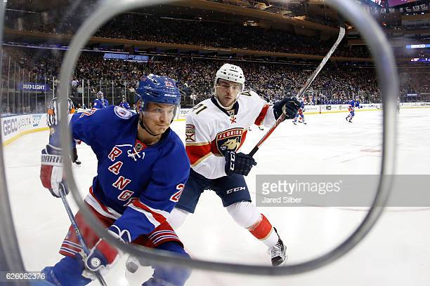Greg McKegg of the Florida Panthers throws a hit against Nick Holden of the New York Rangers at Madison Square Garden on November 20 2016 in New York...