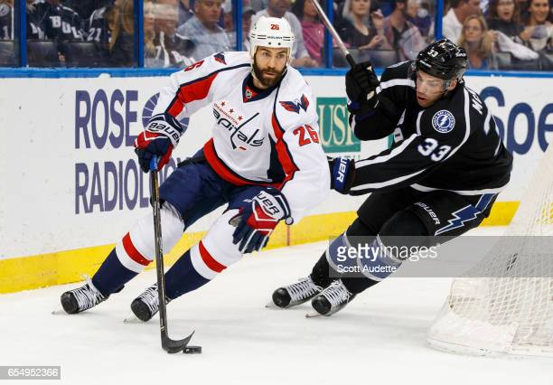 Greg McKegg of the Tampa Bay Lightning chases Daniel Winnik of the Washington Capitals during the first period at Amalie Arena on March 18 2017 in...