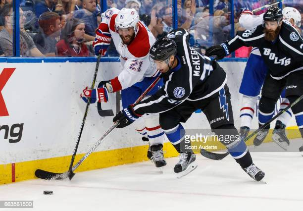 Greg McKegg of the Tampa Bay Lightning skates against Dwight King of the Montreal Canadiens during second period at Amalie Arena on April 1 2017 in...