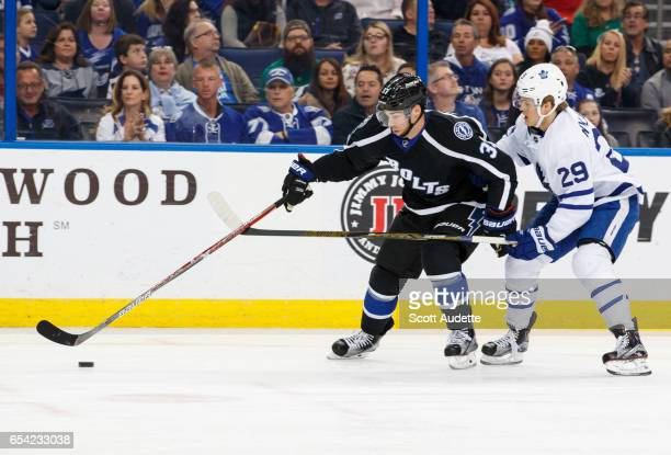Greg McKegg of the Tampa Bay Lightning skates against William Nylander of the Toronto Maple Leafs during the first period at Amalie Arena on March 16...