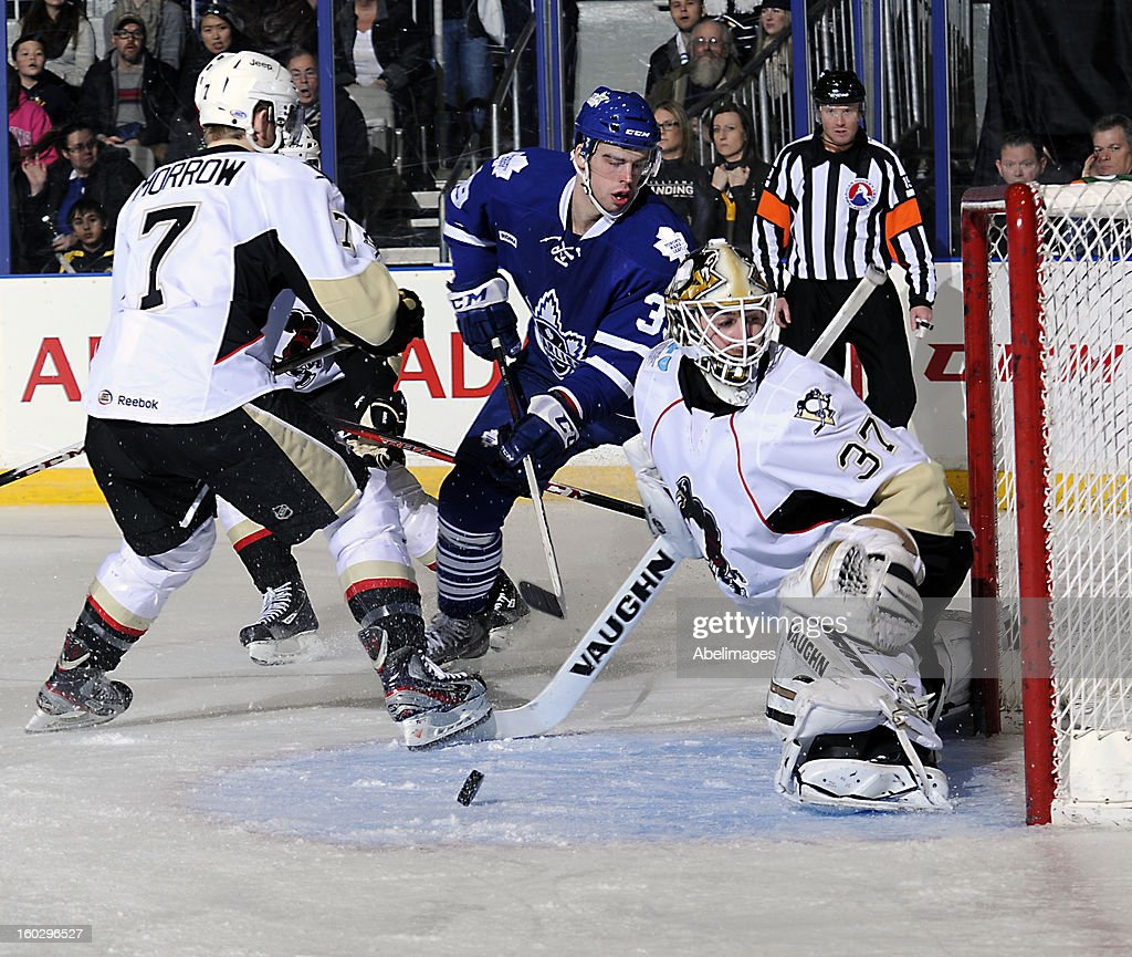 Greg McKegg #39 of the Toronto Marlies looks for a rebound off of goalie Jeff Zatkoff #39 of the Wilkes-Barre Scranton Penguins on January 26, 2013 at Ricoh Coliseum in Toronto, Ontario, Canada.
