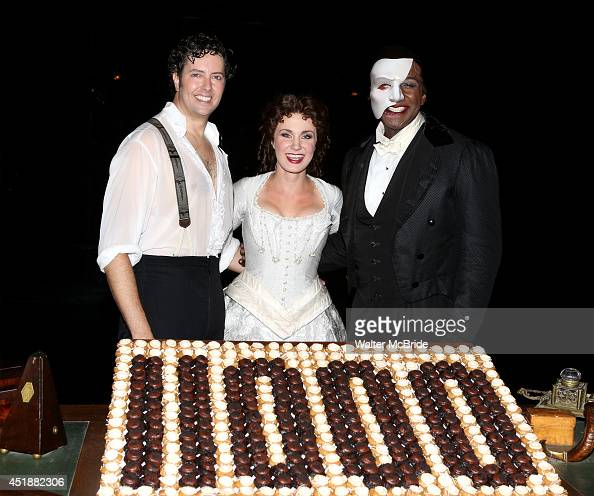 Greg Mills Norm Lewis and Sierra Boggess backstage at the 'Phantom Of The Opera' 11000th Broadway Celebration at the Majestic Theatre on July 8 2014...