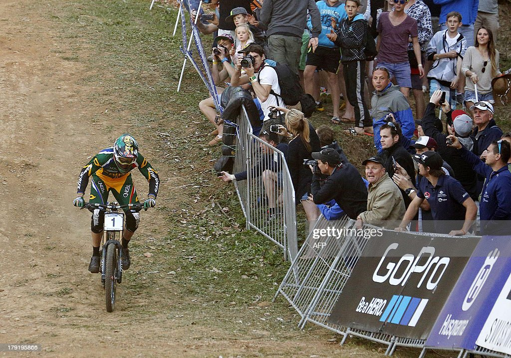 Greg Minnaar of South Africa arrives to the finish line to win the downhill finals during the cross-country world championships at the CASCADES Mountain Bike Track in Pietermaritzburg, on September 1, 2013. AFP PHOTO / Anesh Debiky