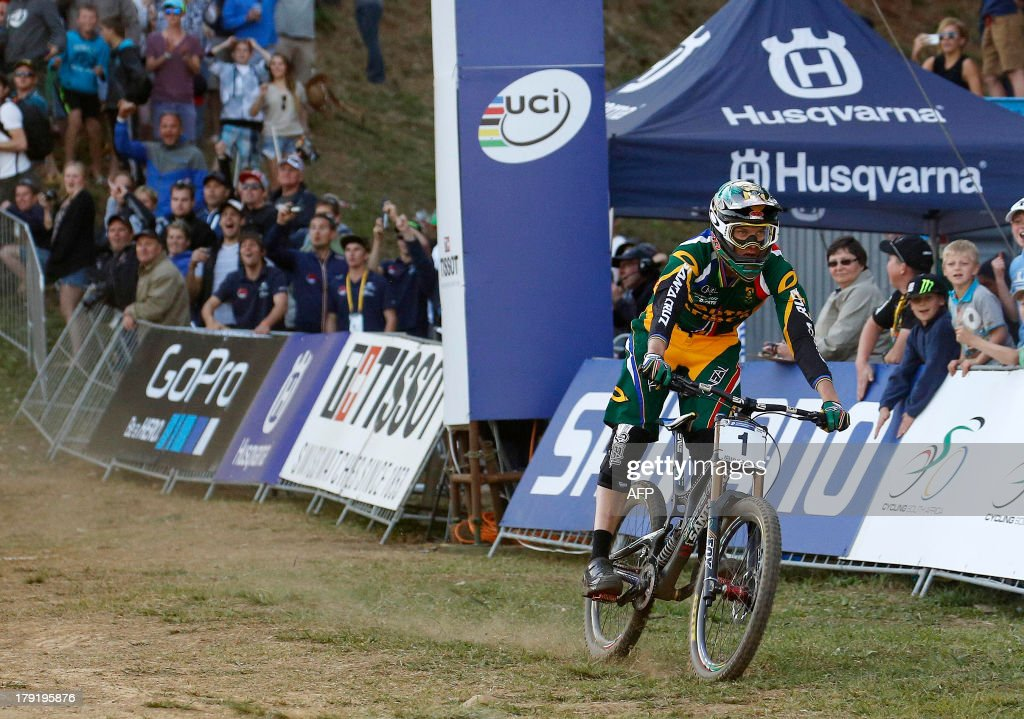 Greg Minnaar of South Africa crosses the finish line to win the downhill finals during the cross-country world championships at the CASCADES Mountain Bike Track in Pietermaritzburg, on September 1, 2013. AFP PHOTO / Anesh Debiky
