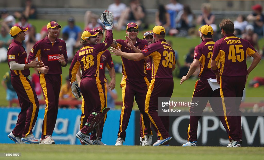 Greg Moller of the Bulls celebrates with his team mates after taking a catch to dismiss David Warner of the Blues during the Ryobi Cup Final match between the Queensland Bulls and the New South Wales Blues at North Sydney Oval on October 27, 2013 in Sydney, Australia.