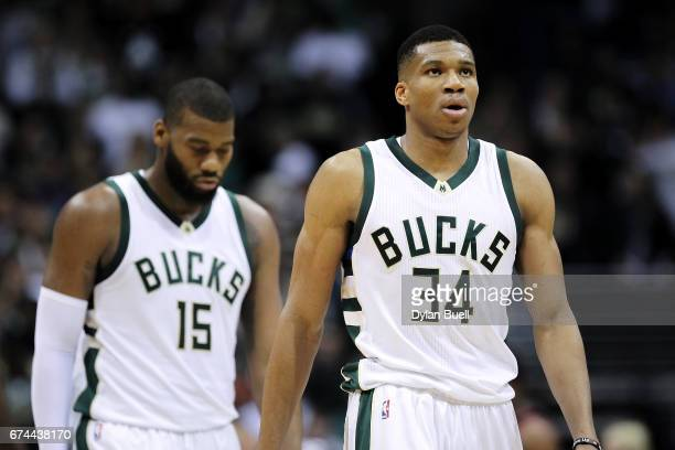 Greg Monroe and Giannis Antetokounmpo of the Milwaukee Bucks walk across the court in the fourth quarter in Game Six of the Eastern Conference...