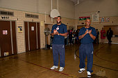 Greg Monroe and Quentin Richardson of the Detroit Pistons claps hands as they renovate a library as part of the NBA's Live Learn and Play Program...