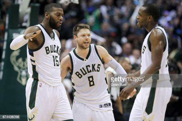 Greg Monroe Matthew Dellavedova and Khris Middleton of the Milwaukee Bucks celebrate in the fourth quarter in Game Six of the Eastern Conference...