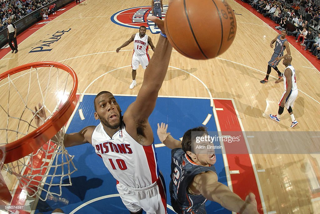 <a gi-track='captionPersonalityLinkClicked' href=/galleries/search?phrase=Greg+Monroe&family=editorial&specificpeople=5042440 ng-click='$event.stopPropagation()'>Greg Monroe</a> #10 of the Detroit Pistons and <a gi-track='captionPersonalityLinkClicked' href=/galleries/search?phrase=Eduardo+Najera&family=editorial&specificpeople=202652 ng-click='$event.stopPropagation()'>Eduardo Najera</a> #21 of the Charlotte Bobcats jumps for a rebound during the game on March 31, 2012 at The Palace of Auburn Hills in Auburn Hills, Michigan.