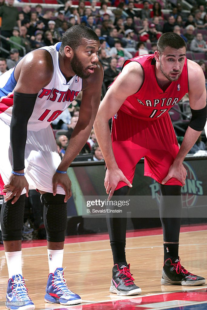Greg Monroe #10 of the Detroit Pistons and Jonas Valanciunas #17 of the Toronto Raptors look on during the game between the Detroit Pistons and the Toronto Raptors on March 29, 2013 at The Palace of Auburn Hills in Auburn Hills, Michigan.