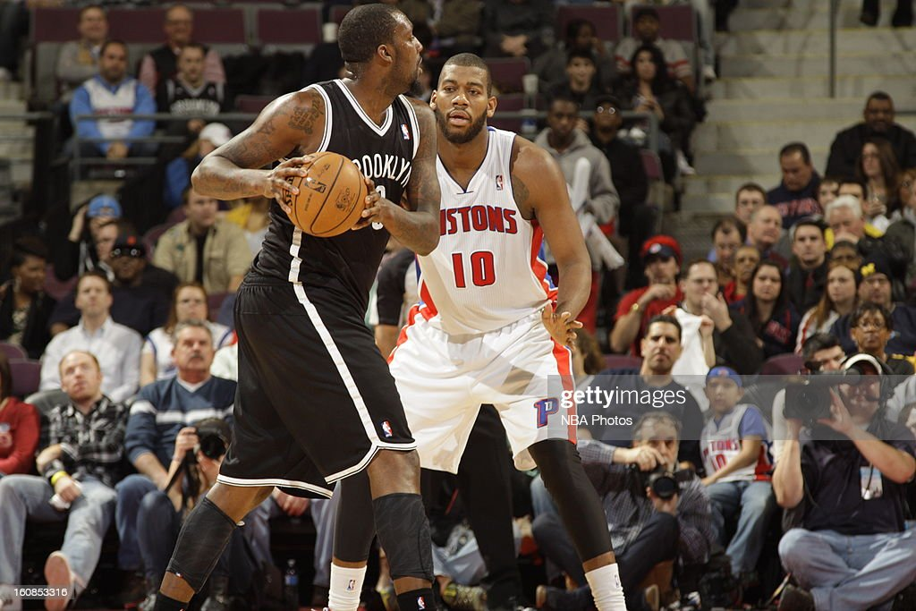 <a gi-track='captionPersonalityLinkClicked' href=/galleries/search?phrase=Greg+Monroe&family=editorial&specificpeople=5042440 ng-click='$event.stopPropagation()'>Greg Monroe</a> #10 of the Detroit Pistons defends <a gi-track='captionPersonalityLinkClicked' href=/galleries/search?phrase=Andray+Blatche&family=editorial&specificpeople=4282797 ng-click='$event.stopPropagation()'>Andray Blatche</a> #0 of the Brooklyn Nets during the game on February 6, 2013 at The Palace of Auburn Hills in Auburn Hills, Michigan.