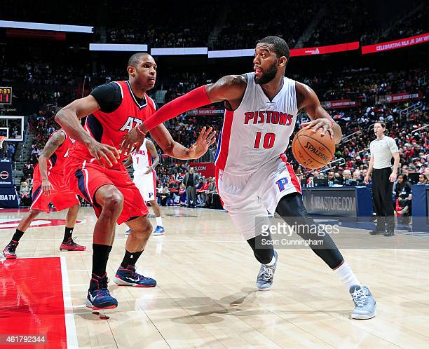 Greg Monroe of the Detroit Pistons drives against Al Horford of the Atlanta Hawks on January 19 2015 at Philips Arena in Atlanta Georgia NOTE TO USER...