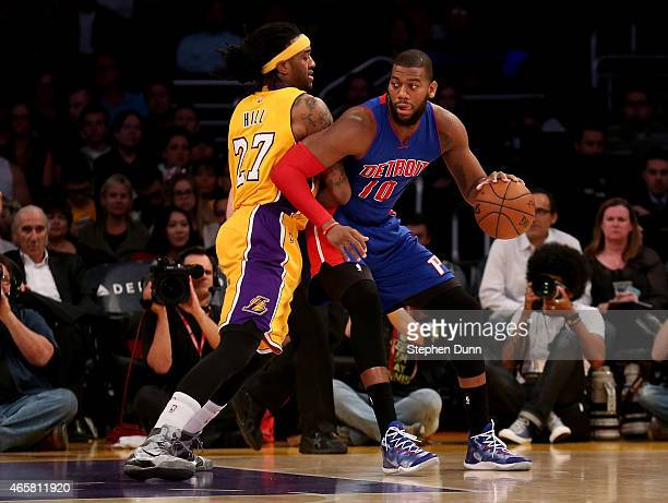 Greg Monroe of the Detroit Pistons drives against Jordan Hill of the Los Angeles Lakers at Staples Center on March 10 2015 in Los Angeles California...