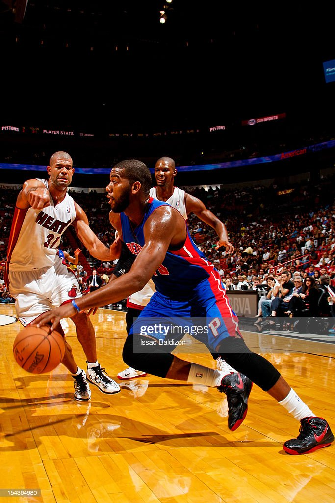 <a gi-track='captionPersonalityLinkClicked' href=/galleries/search?phrase=Greg+Monroe&family=editorial&specificpeople=5042440 ng-click='$event.stopPropagation()'>Greg Monroe</a> #10 of the Detroit Pistons drives against <a gi-track='captionPersonalityLinkClicked' href=/galleries/search?phrase=Shane+Battier&family=editorial&specificpeople=201814 ng-click='$event.stopPropagation()'>Shane Battier</a> #31 of the Miami Heat during a pre-season game on October 18, 2012 at American Airlines Arena in Miami, Florida.