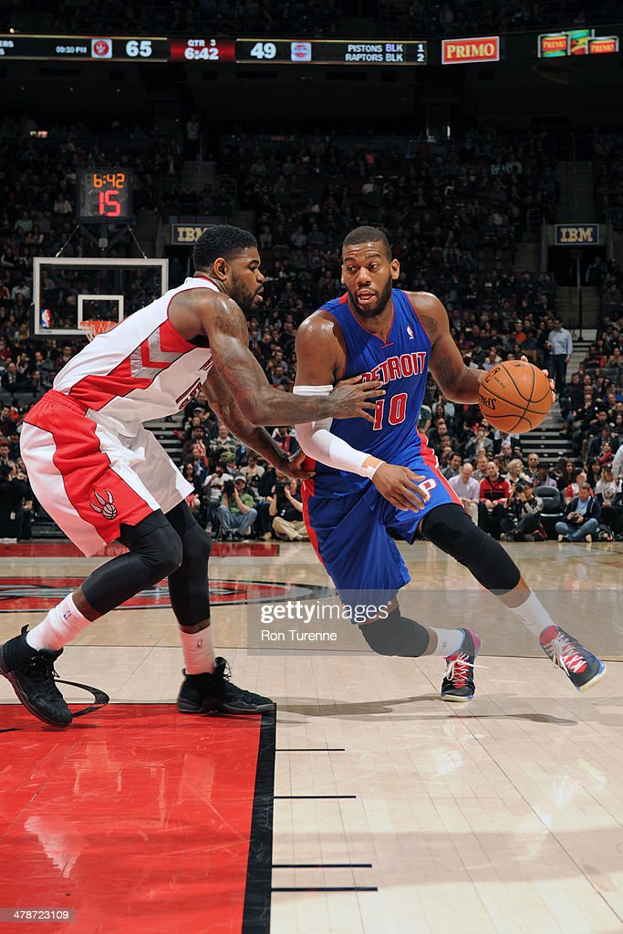 <a gi-track='captionPersonalityLinkClicked' href=/galleries/search?phrase=Greg+Monroe&family=editorial&specificpeople=5042440 ng-click='$event.stopPropagation()'>Greg Monroe</a> #10 of the Detroit Pistons drives against the Toronto Raptors on March 12, 2014 at the Air Canada Centre in Toronto, Ontario, Canada.