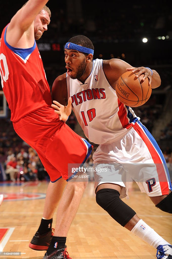 <a gi-track='captionPersonalityLinkClicked' href=/galleries/search?phrase=Greg+Monroe&family=editorial&specificpeople=5042440 ng-click='$event.stopPropagation()'>Greg Monroe</a> #10 of the Detroit Pistons drives around defense during the game between the Detroit Pistons and the Philadelphia 76ers on April 26, 2012 at The Palace of Auburn Hills in Auburn Hills, Michigan.