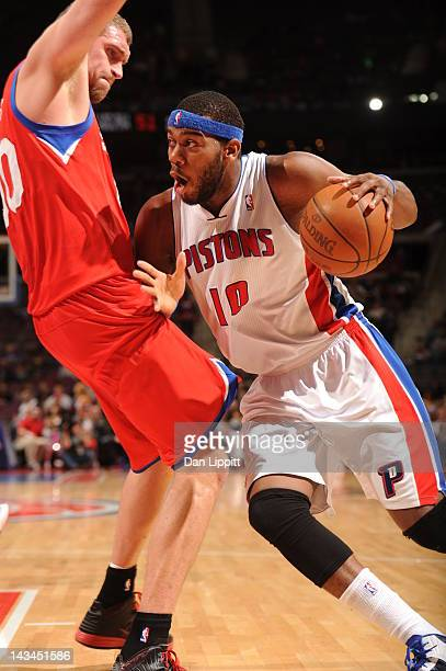 Greg Monroe of the Detroit Pistons drives around defense during the game between the Detroit Pistons and the Philadelphia 76ers on April 26 2012 at...