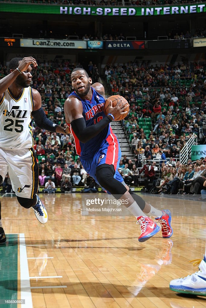 <a gi-track='captionPersonalityLinkClicked' href=/galleries/search?phrase=Greg+Monroe&family=editorial&specificpeople=5042440 ng-click='$event.stopPropagation()'>Greg Monroe</a> #10 of the Detroit Pistons drives to the basket against <a gi-track='captionPersonalityLinkClicked' href=/galleries/search?phrase=Al+Jefferson&family=editorial&specificpeople=201604 ng-click='$event.stopPropagation()'>Al Jefferson</a> #25 of the Utah Jazz at Energy Solutions Arena on March 11, 2013 in Salt Lake City, Utah.