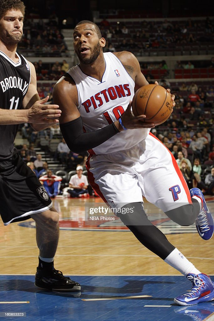 Greg Monroe #10 of the Detroit Pistons drives to the basket against Brook Lopez #11 of the Brooklyn Nets on February 6, 2013 at The Palace of Auburn Hills in Auburn Hills, Michigan.
