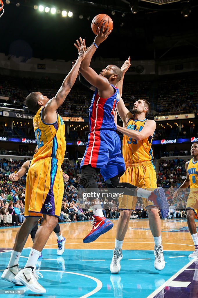 Greg Monroe #10 of the Detroit Pistons drives to the basket against Lance Thomas #42 and Ryan Anderson #33 of the New Orleans Hornets on March 1, 2013 at the New Orleans Arena in New Orleans, Louisiana.