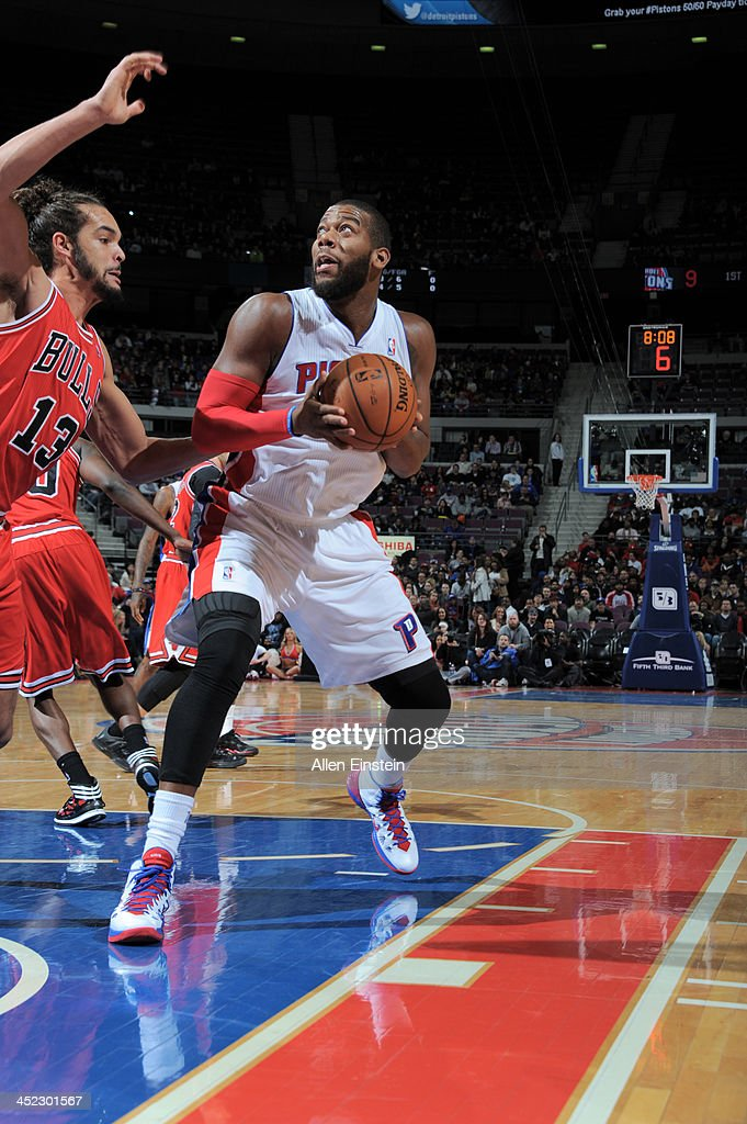 Greg Monroe #10 of the Detroit Pistons drives to the basket against Joakim Noah #13 of the Chicago Bulls on November 27, 2013 at The Palace of Auburn Hills in Auburn Hills, Michigan.
