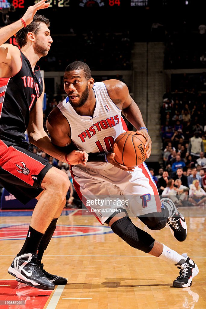 Greg Monroe #10 of the Detroit Pistons drives to the basket against Andrea Bargnani #7 of the Toronto Raptors on November 23, 2012 at The Palace of Auburn Hills in Auburn Hills, Michigan.