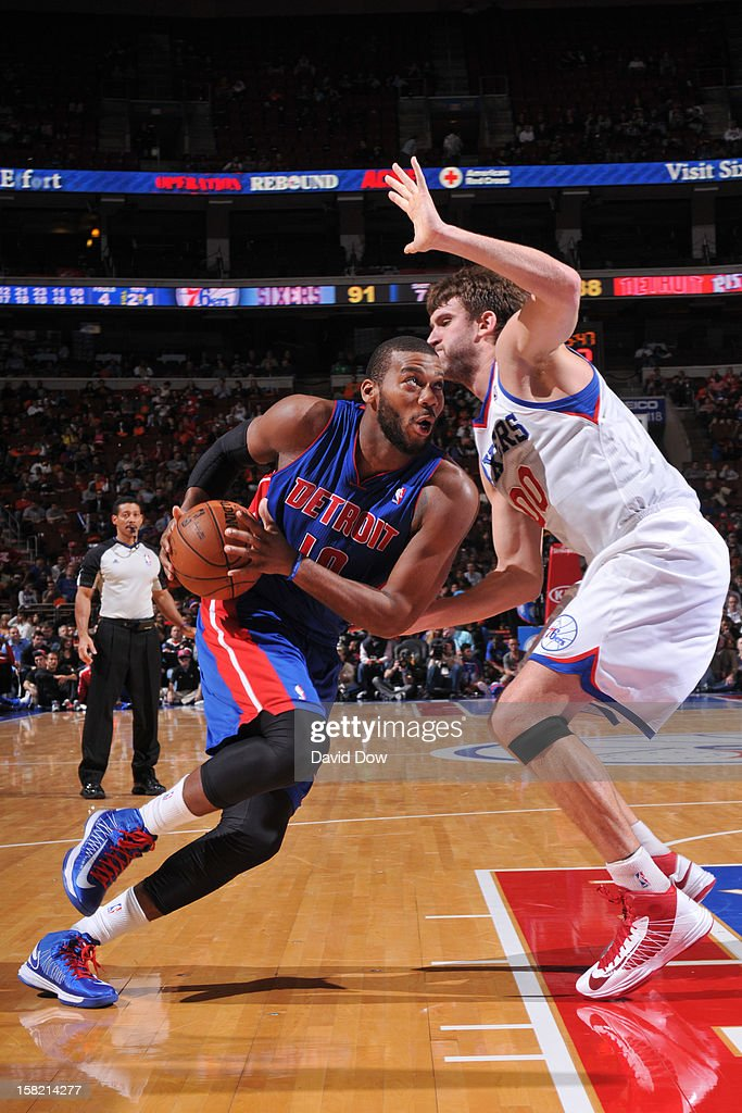 <a gi-track='captionPersonalityLinkClicked' href=/galleries/search?phrase=Greg+Monroe&family=editorial&specificpeople=5042440 ng-click='$event.stopPropagation()'>Greg Monroe</a> #10 of the Detroit Pistons drives to the basket against <a gi-track='captionPersonalityLinkClicked' href=/galleries/search?phrase=Spencer+Hawes&family=editorial&specificpeople=3848319 ng-click='$event.stopPropagation()'>Spencer Hawes</a> #00 of the Philadelphia 76ers during the game at the Wells Fargo Center on December 10, 2012 in Philadelphia, Pennsylvania.