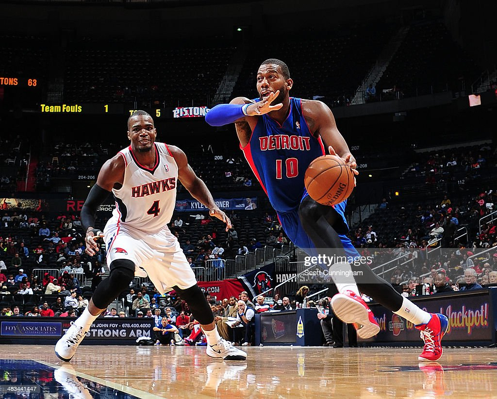 <a gi-track='captionPersonalityLinkClicked' href=/galleries/search?phrase=Greg+Monroe&family=editorial&specificpeople=5042440 ng-click='$event.stopPropagation()'>Greg Monroe</a> #10 of the Detroit Pistons drives to the basket against Paul Millsap #4 of the Atlanta Hawks on April 8, 2014 at Philips Arena in Atlanta, Georgia.