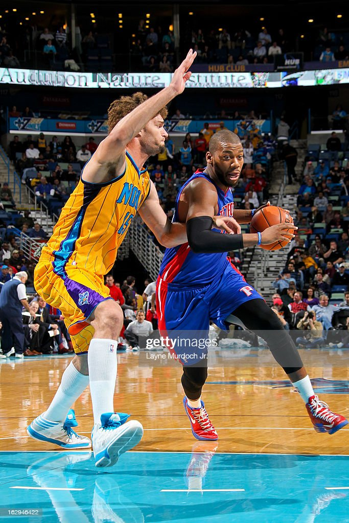 Greg Monroe #10 of the Detroit Pistons drives to the basket against Robin Lopez #15 of the New Orleans Hornets on March 1, 2013 at the New Orleans Arena in New Orleans, Louisiana.