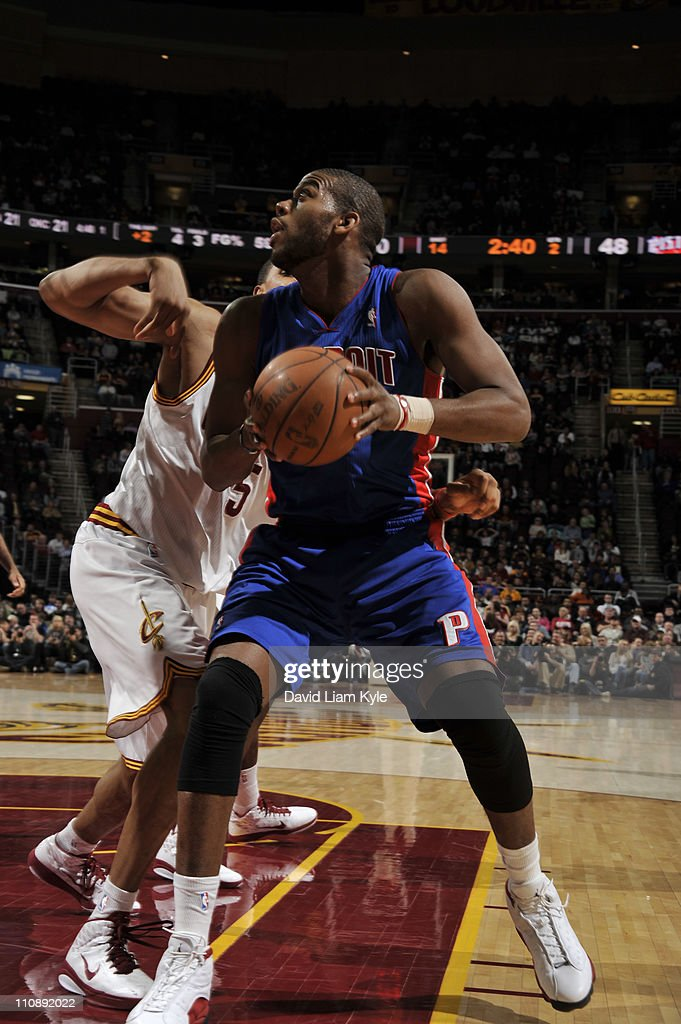 Greg Monroe #10 of the Detroit Pistons drives to the basket against Ryan Hollins #5 of the Cleveland Cavaliers during the game at The Quicken Loans Arena on March 25, 2011 in Cleveland, Ohio.