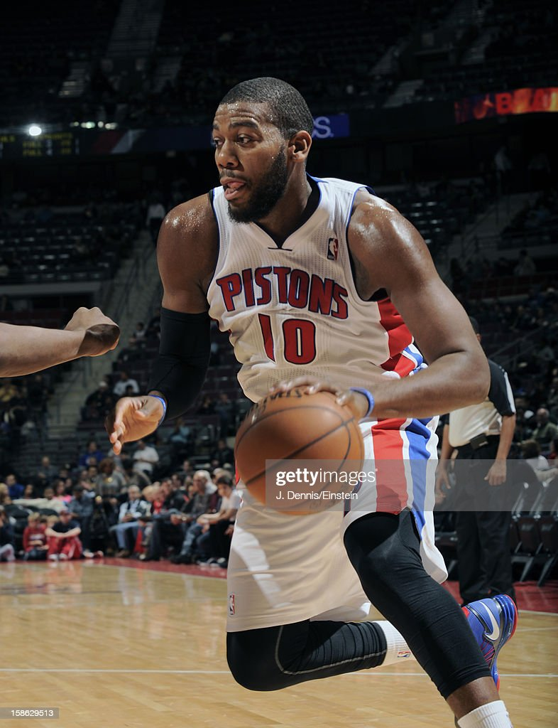 Greg Monroe #10 of the Detroit Pistons drives to the basket against the Washington Wizards during the game on December 21, 2012 at The Palace of Auburn Hills in Auburn Hills, Michigan.
