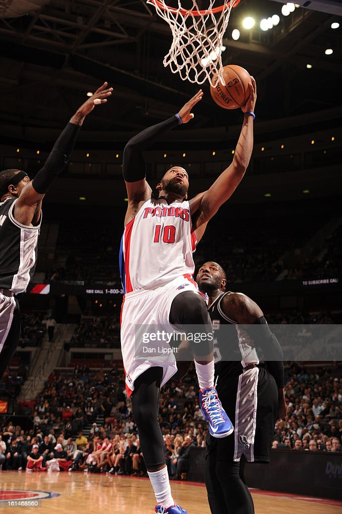 Greg Monroe #10 of the Detroit Pistons drives to the basket against the San Antonio Spurs on February 8, 2013 at The Palace of Auburn Hills in Auburn Hills, Michigan.