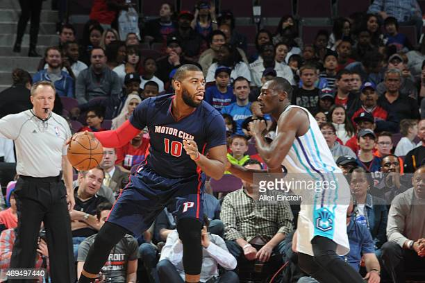 Greg Monroe of the Detroit Pistons drives to the basket against the Charlotte Hornets during the game on April 12 2015 at The Palace of Auburn in...