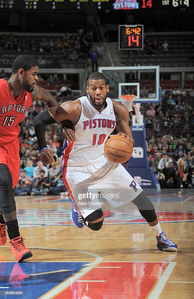 Greg Monroe #10 of the Detroit Pistons drives up court against Amir Johnson #15 of the Toronto Raptors during the game between the Detroit Pistons and the Toronto Raptors on March 29, 2013 at The Palace of Auburn Hills in Auburn Hills, Michigan.