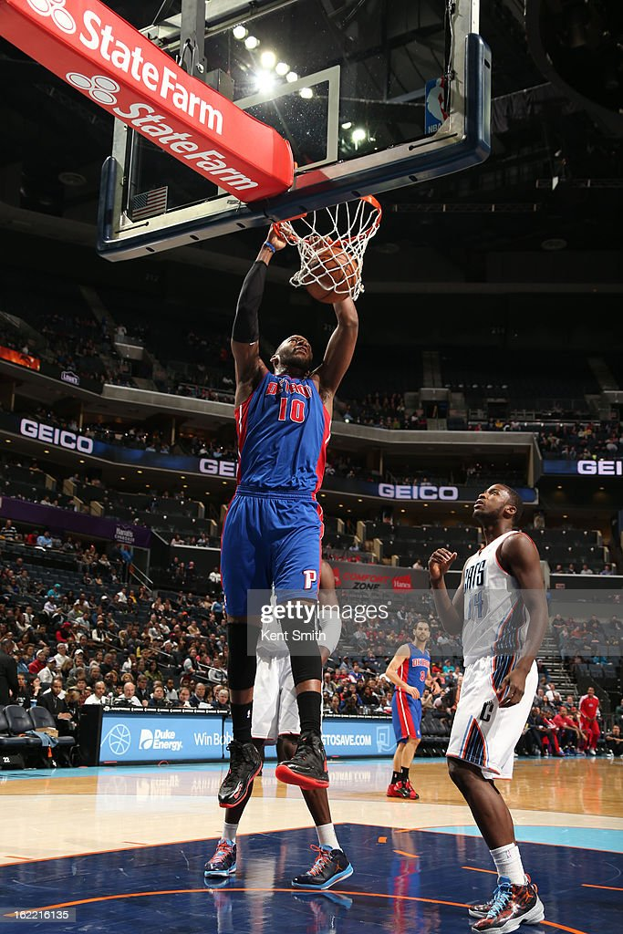 <a gi-track='captionPersonalityLinkClicked' href=/galleries/search?phrase=Greg+Monroe&family=editorial&specificpeople=5042440 ng-click='$event.stopPropagation()'>Greg Monroe</a> #10 of the Detroit Pistons dunks against <a gi-track='captionPersonalityLinkClicked' href=/galleries/search?phrase=Michael+Kidd-Gilchrist&family=editorial&specificpeople=8526214 ng-click='$event.stopPropagation()'>Michael Kidd-Gilchrist</a> #14 of the Charlotte Bobcats at the Time Warner Cable Arena on February 20, 2013 in Charlotte, North Carolina.