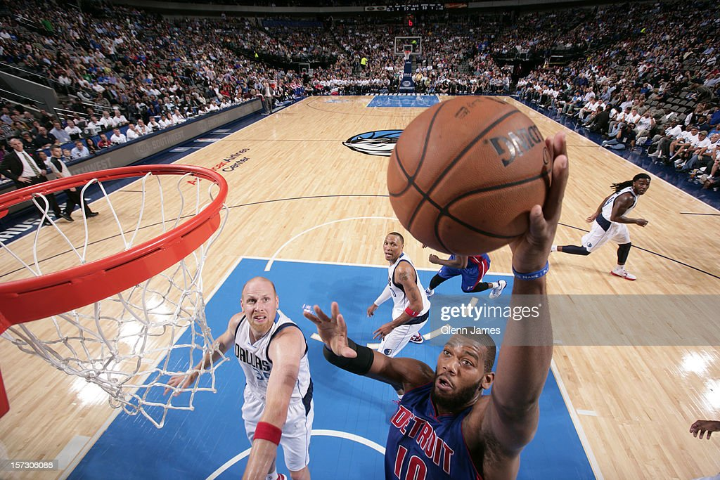 <a gi-track='captionPersonalityLinkClicked' href=/galleries/search?phrase=Greg+Monroe&family=editorial&specificpeople=5042440 ng-click='$event.stopPropagation()'>Greg Monroe</a> #10 of the Detroit Pistons goes in for the dunk against <a gi-track='captionPersonalityLinkClicked' href=/galleries/search?phrase=Chris+Kaman&family=editorial&specificpeople=201661 ng-click='$event.stopPropagation()'>Chris Kaman</a> #35 of the Dallas Mavericks on December 1, 2012 at the American Airlines Center in Dallas, Texas.