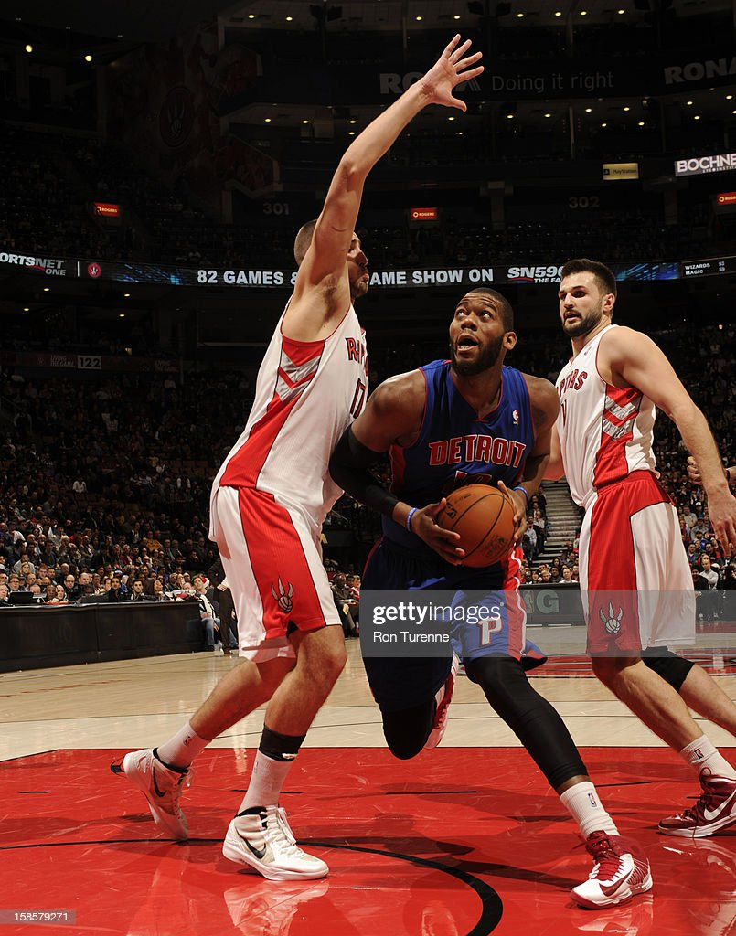 <a gi-track='captionPersonalityLinkClicked' href=/galleries/search?phrase=Greg+Monroe&family=editorial&specificpeople=5042440 ng-click='$event.stopPropagation()'>Greg Monroe</a> #10 of the Detroit Pistons goes up for the shot in traffic against the Toronto Raptors during the game on December 19, 2012 at the Air Canada Centre in Toronto, Ontario, Canada.