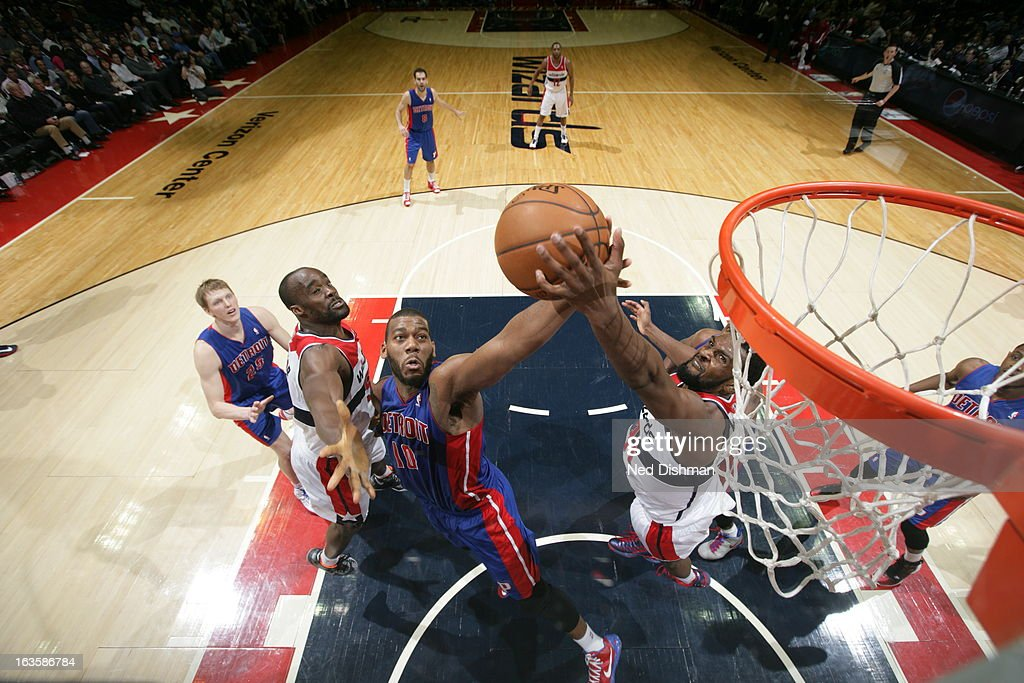 <a gi-track='captionPersonalityLinkClicked' href=/galleries/search?phrase=Greg+Monroe&family=editorial&specificpeople=5042440 ng-click='$event.stopPropagation()'>Greg Monroe</a> #10 of the Detroit Pistons grabs a rebound against <a gi-track='captionPersonalityLinkClicked' href=/galleries/search?phrase=Emeka+Okafor&family=editorial&specificpeople=201739 ng-click='$event.stopPropagation()'>Emeka Okafor</a> #50 and <a gi-track='captionPersonalityLinkClicked' href=/galleries/search?phrase=Chris+Singleton&family=editorial&specificpeople=241555 ng-click='$event.stopPropagation()'>Chris Singleton</a> #31 of the Washington Wizards at the Verizon Center on February 27, 2013 in Washington, DC.