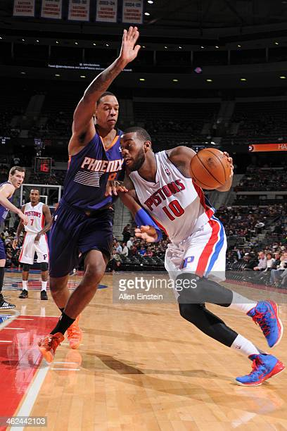 Greg Monroe of the Detroit Pistons handles the ball against Channing Frye of the Phoenix Suns on January 11 2014 at The Palace of Auburn Hills in...