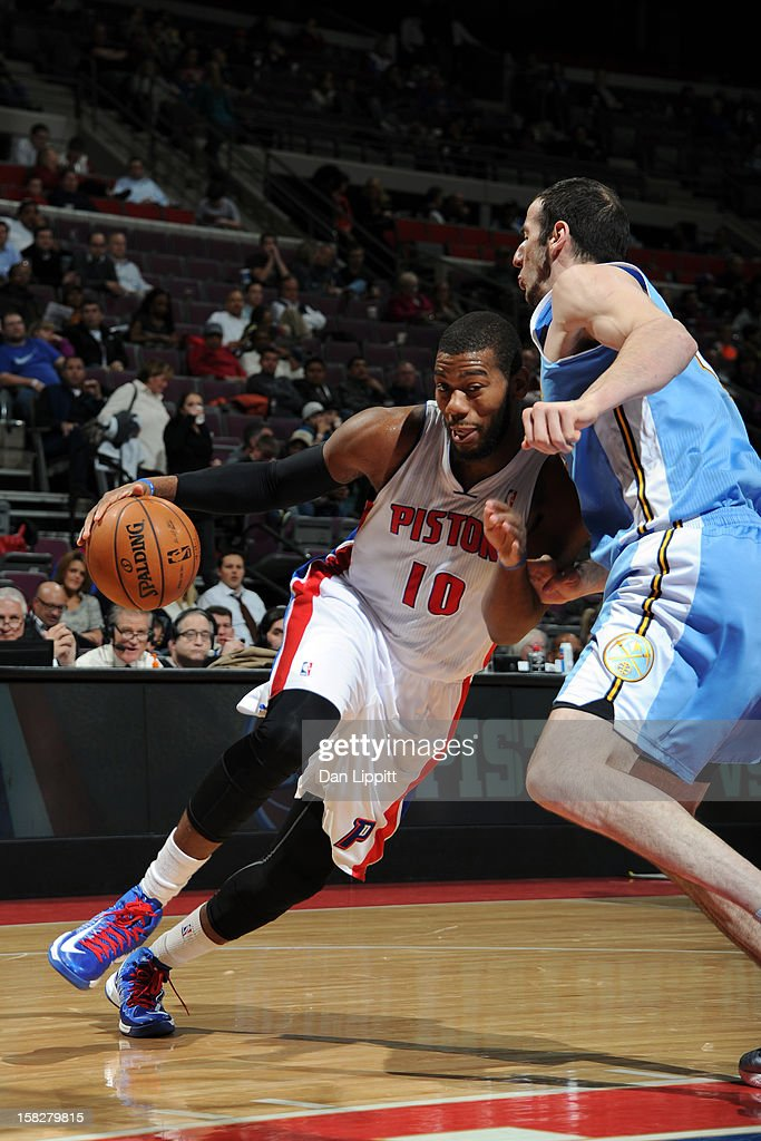 Greg Monroe #10 of the Detroit Pistons handles the ball against the Denver Nuggets on December 11, 2012 at The Palace of Auburn Hills in Auburn Hills, Michigan.