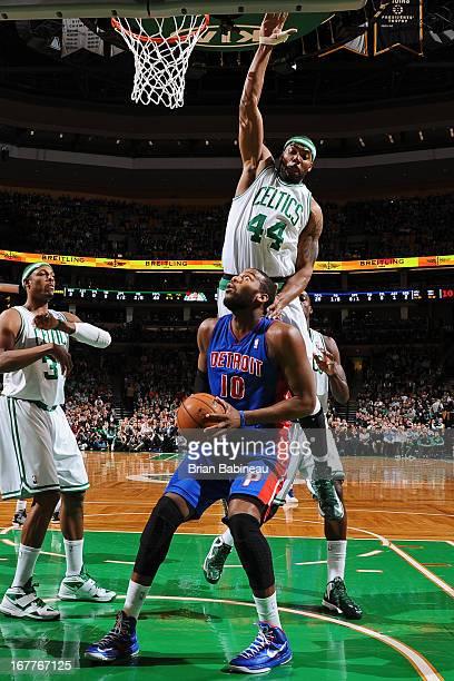 Greg Monroe of the Detroit Pistons looks to shoot against Chris Wilcox of the Boston Celtics on April 3 2013 at the TD Garden in Boston Massachusetts...