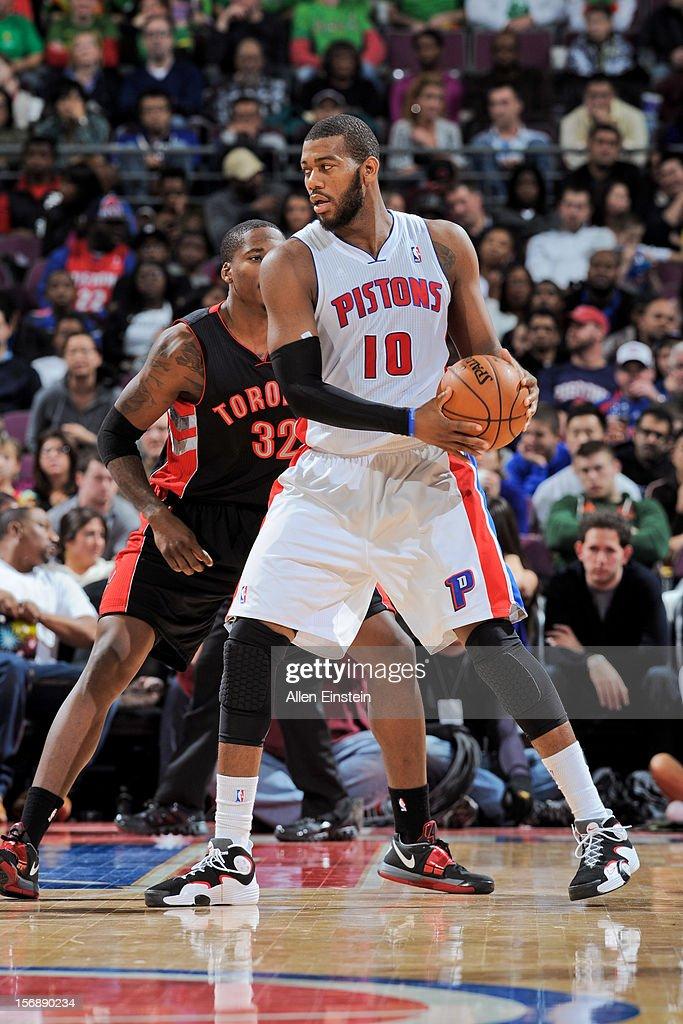 Greg Monroe #10 of the Detroit Pistons posts-up against Ed Davis #32 of the Toronto Raptors on November 23, 2012 at The Palace of Auburn Hills in Auburn Hills, Michigan.