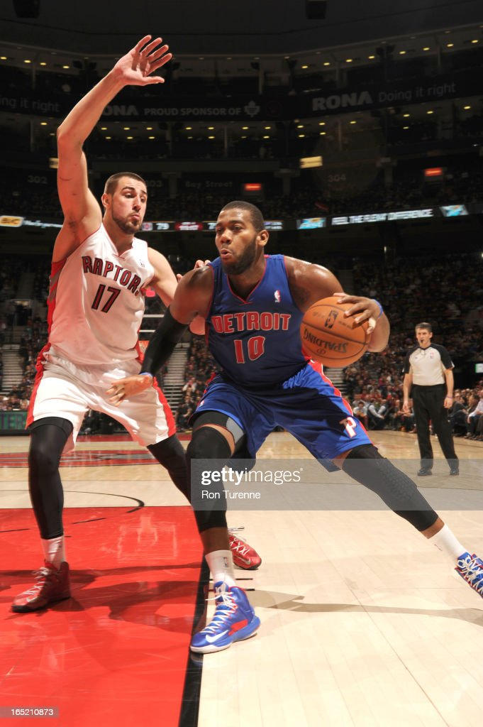 <a gi-track='captionPersonalityLinkClicked' href=/galleries/search?phrase=Greg+Monroe&family=editorial&specificpeople=5042440 ng-click='$event.stopPropagation()'>Greg Monroe</a> #10 of the Detroit Pistons protects the ball from <a gi-track='captionPersonalityLinkClicked' href=/galleries/search?phrase=Jonas+Valanciunas&family=editorial&specificpeople=5654195 ng-click='$event.stopPropagation()'>Jonas Valanciunas</a> #17 of the Toronto Raptors during the game between the Toronto Raptors and the Detroit Pistons on April 1, 2013 at the Air Canada Centre in Toronto, Ontario, Canada.