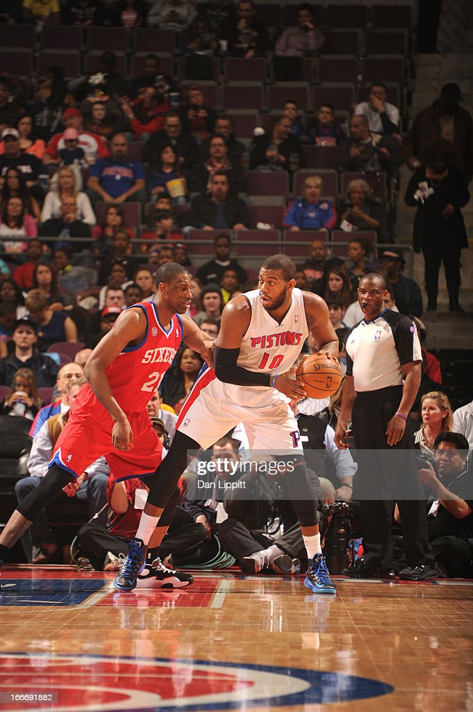 Greg Monroe #10 of the Detroit Pistons protects the ball from Thaddeus Young #21 of the Philadelphia 76ers during the game between the Detroit Pistons and the Philadelphia 76ers on April 15, 2013 at The Palace of Auburn Hills in Auburn Hills, Michigan.