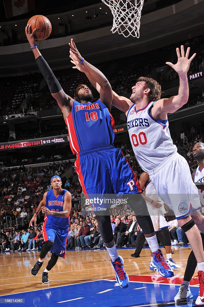 <a gi-track='captionPersonalityLinkClicked' href=/galleries/search?phrase=Greg+Monroe&family=editorial&specificpeople=5042440 ng-click='$event.stopPropagation()'>Greg Monroe</a> #10 of the Detroit Pistons puts ip a shot over <a gi-track='captionPersonalityLinkClicked' href=/galleries/search?phrase=Spencer+Hawes&family=editorial&specificpeople=3848319 ng-click='$event.stopPropagation()'>Spencer Hawes</a> #00 of the Philadelphia 76ers during the game at the Wells Fargo Center on December 10, 2012 in Philadelphia, Pennsylvania.