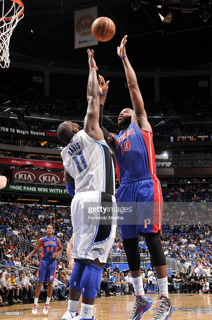 Greg Monroe #10 of the Detroit Pistons sends the ball over Glen Davis #11 of the Orlando Magic during the game between the Detroit Pistons and the Orlando Magic on January 27, 2013 at Amway Center in Orlando, Florida.