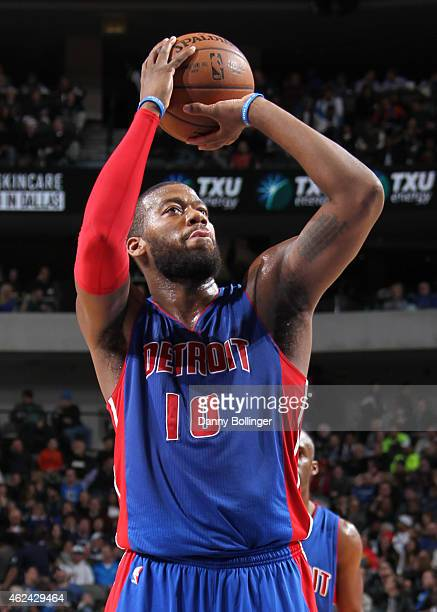 Greg Monroe of the Detroit Pistons shoots a free throw against the Dallas Mavericks on January 7 2015 at the American Airlines Center in Dallas Texas...