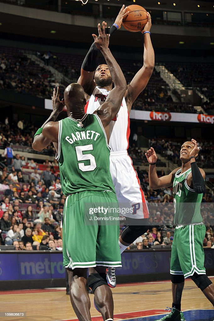 Greg Monroe #10 of the Detroit Pistons shoots against Kevin Garnett #5 of the Boston Celtics on January 20, 2013 at The Palace of Auburn Hills in Auburn Hills, Michigan.