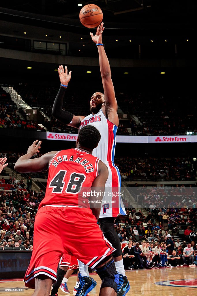 <a gi-track='captionPersonalityLinkClicked' href=/galleries/search?phrase=Greg+Monroe&family=editorial&specificpeople=5042440 ng-click='$event.stopPropagation()'>Greg Monroe</a> #10 of the Detroit Pistons shoots against <a gi-track='captionPersonalityLinkClicked' href=/galleries/search?phrase=Nazr+Mohammed&family=editorial&specificpeople=201690 ng-click='$event.stopPropagation()'>Nazr Mohammed</a> #48 of the Chicago Bulls on April 7, 2013 at The Palace of Auburn Hills in Auburn Hills, Michigan.