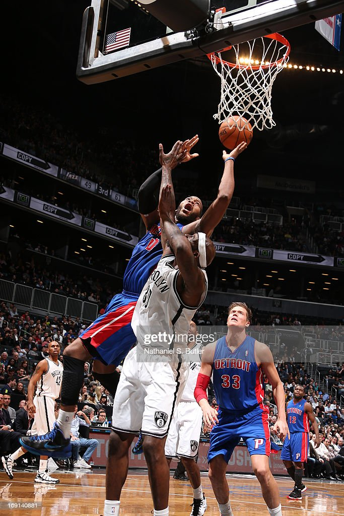 Greg Monroe #10 of the Detroit Pistons shoots against Reggie Evans #30 of the Brooklyn Nets on April 17, 2013 at the Barclays Center in the Brooklyn borough of New York City.